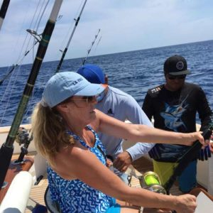 Woman reeling in a big fish